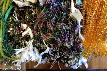 Strings of beads for sale in the store