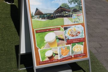 """Just one of the restaurants where you can eat """"in"""" or rather under a roof in the manicured lawns."""