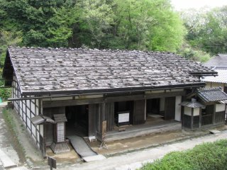 The wooden roof is strengthened with stones