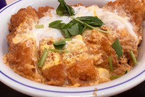 Katsudon, rice bowl topped with deep fried pork cutlet  and egg sauce.