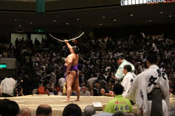 Bow-twirling ceremony, with traditional bamboo 'yumitori-shiki'