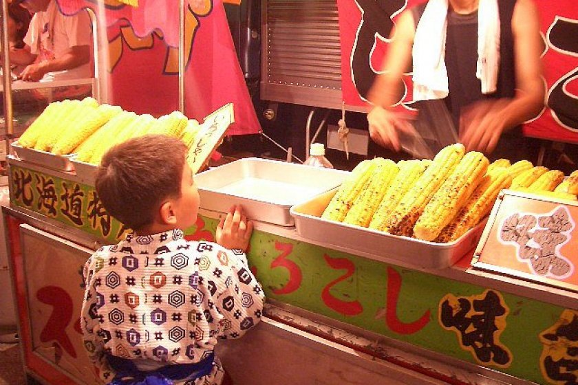 Grilled corn, a staple of the summer festival street stall scene