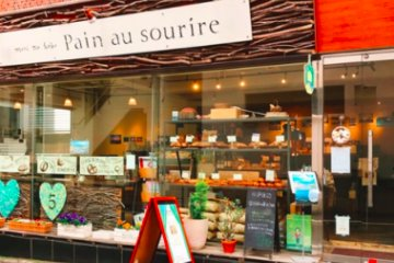 Pain au Sourire showcases their baked good through a glass window