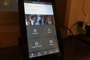In room touch screen that offers information about hotel amenities and services