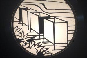 The lantern motif appears on railing pillars