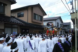 The mikoshi shrine being carried throughout town.