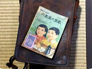 School bag and math textbook