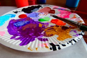 Use a paper plate to mix the colors