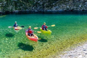 Canoeing down the transparent mountain streams