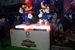 Mario and Sonic teaming up to compete.