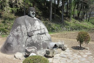 Stone Buddha bringing good fortune