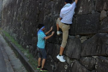 The steep walls of the castle were meant to keep out ruthless warriors. Let's hope they can keep curious Japanese children out too!