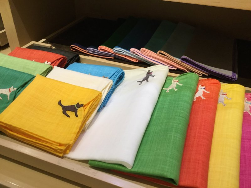 Whimsical handkerchiefs: dogs tugging the edge.