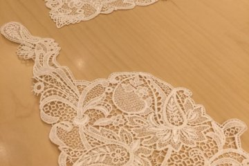 One small corner of a lace handkerchief...
