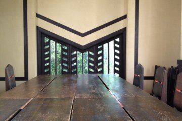 Large wodden tables and a lots of light are characteristic for the dining room
