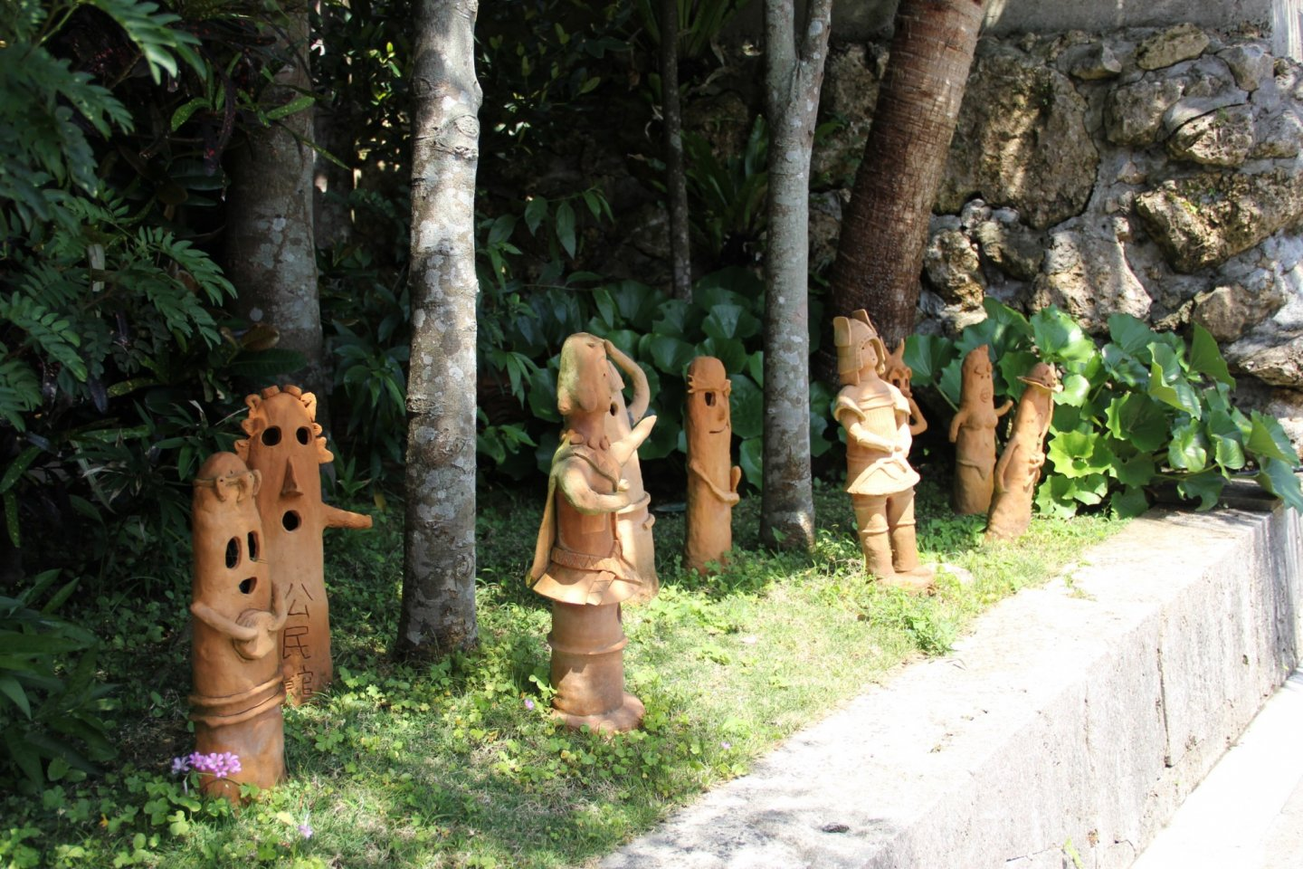 Okinawan art made of Ryukyuan red tile on display along the pathway to the Nakamura House in Kitanakagusuku