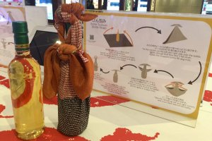 At the workshop area, learn how to use a furoshiki to wrap things like wine bottles.