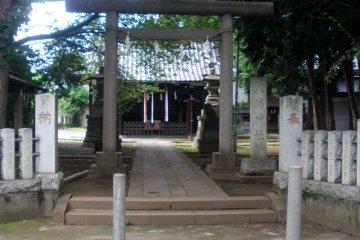 Torii gate entrance to Nakamura Hachiman Shrine