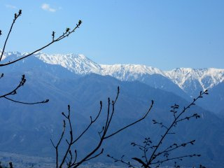 The highest Hida Range mountains are covered with snow