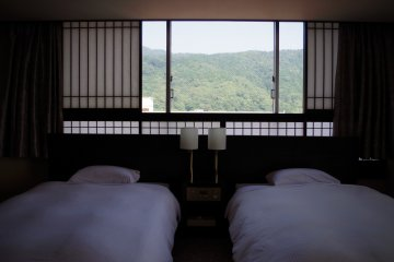 Two single beds in the Western part with paper windows