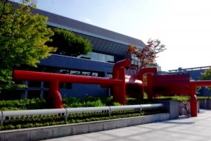 The red sculpture whose design is inspired by the shrine torii gates nearby