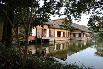 Main building overlooking Yokokan Garden's lake