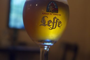 <p>Leffe on draft! Stained glass view behind</p>