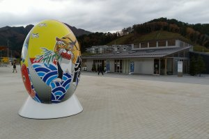 A giant rugby ball in front of the museum