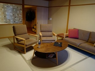The tatami sitting room is relaxing and used for futon beds at night