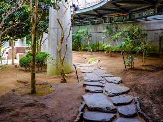 Stone paths weave their way through the dirt inside the EGG