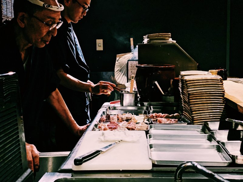 The yakitori chefs preparing the meal