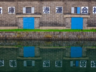 Great warehouse reflections off the silky smooth canal water