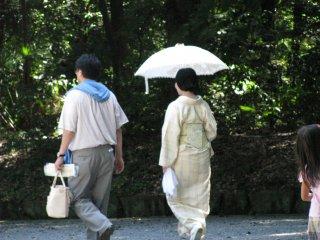 Japanese ladies using sun-proof umbrellas...