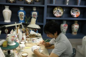 Artists painstakingly hand paint the fine china at Noritake