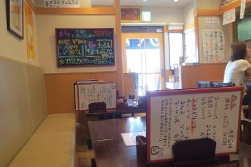 The brightly lit restaurant with its decorations has a fun and comfortable atmosphere