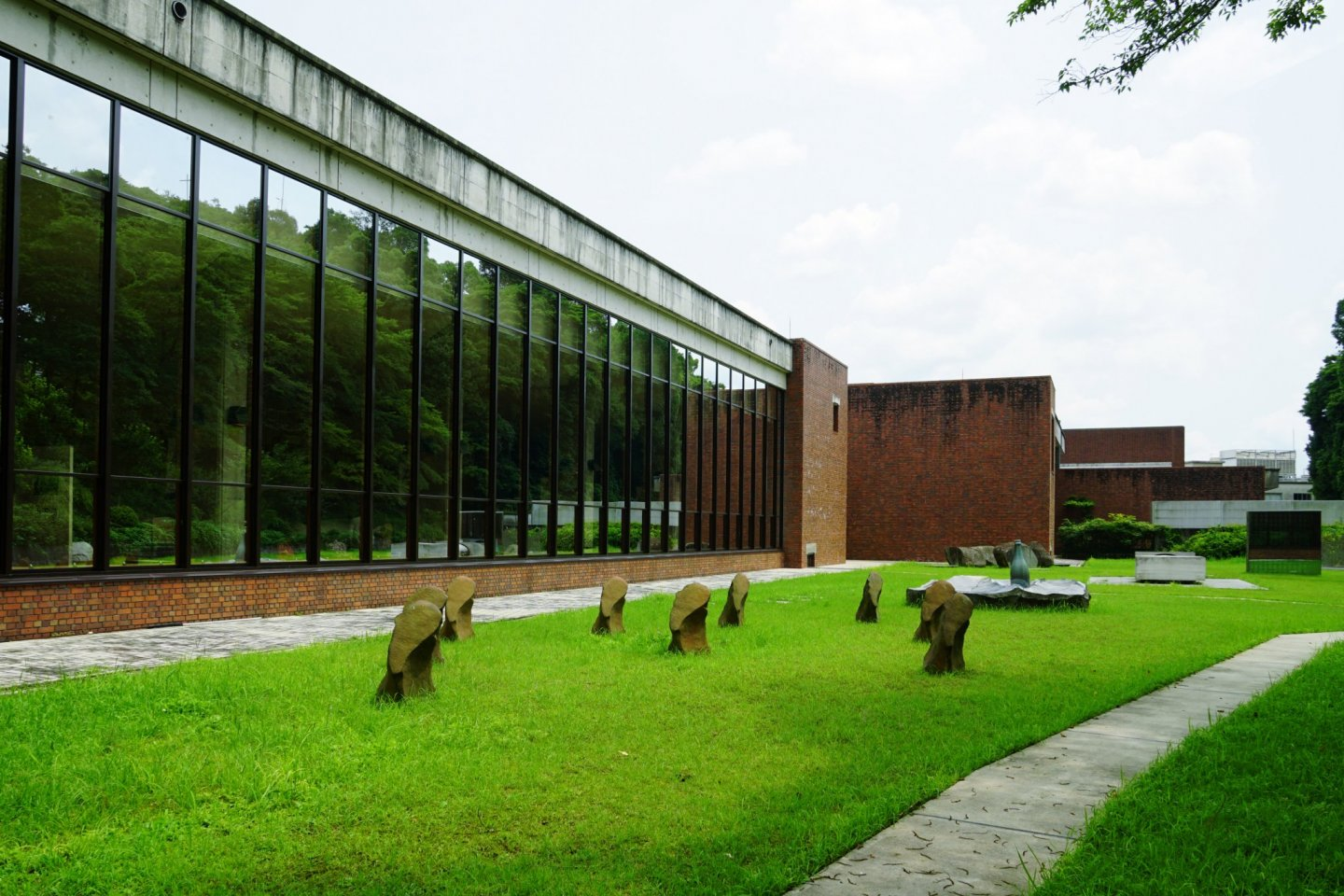 The large windows look out to the surrounding nature