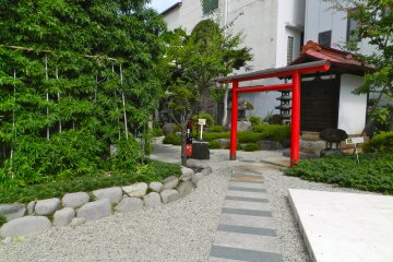 Behind the cafe and soba shop is the pebbled courtyard, with the information centre and gift shop.