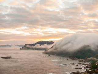 Clouds pool in between mountains, then overflow the ridge line and flow into the Japan Sea in a single burst