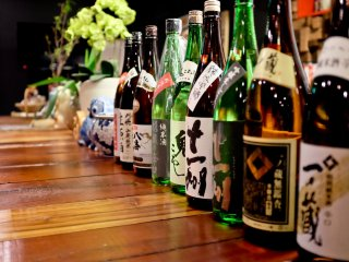 The counter is decorated with various Sake bottles in true Japanese style