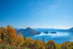 Lake Toya against the autumn leaves