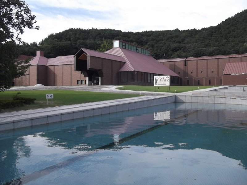 The water feature in front of the museum