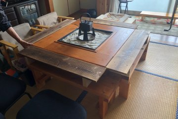 The living room has a rather splendid kotatsu that can also keep your tea warm!