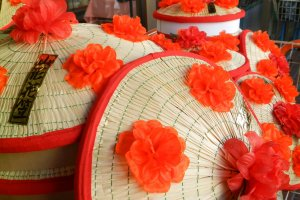 The iconic hanagasa hats with their bright red flowers.