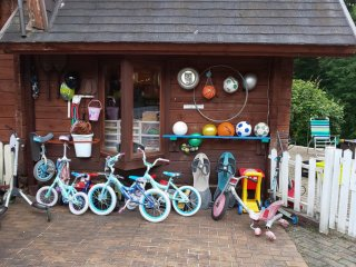 Outside, you can see all the bikes and balls lined up. There is no extra charge to use these. There is also a playground, ping pong and basketball hoops.