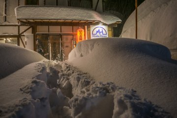 The front of Myoko House after a snowfall