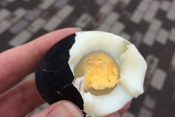 Black egg cooked in the sulphurous hot spring