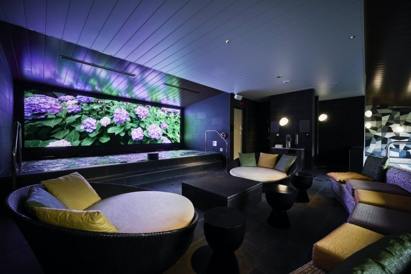 The large communal bath will have seasonally-inspired digital art on display
