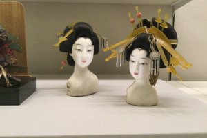Antique dolls in state of the art displays