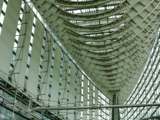 Tokyo International Forum features swooping curves of steel truss and glass; the outside is shaped like an elongated boat