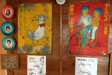 <p>Vintage Japanese safety posters warn youngsters to look both ways and to not ride doubles on a bicycle</p>